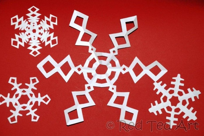 Paper Snowflakes. How to make paper snowflakes - we love 6 pointed snowflakes as they are that little bit more special. Here we show step by step instructions of how to cut a snowflake from paper. #Snowflake #papercrafts #papersnowflakes #winter #christmas #winterdecor #papercraftskids