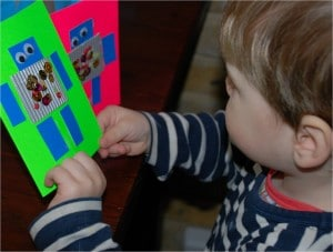Toddler with homemade robot card for dad