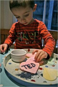 Easy Conversation Heart Cookies. How to make Love Heart Cookies. Homemade Conversation Heart Treats to give to Classmates. Valentines Day Ideas for Kids