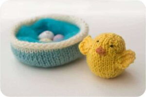 Adorable Chick Crafts for Kids: knitted chick and nest