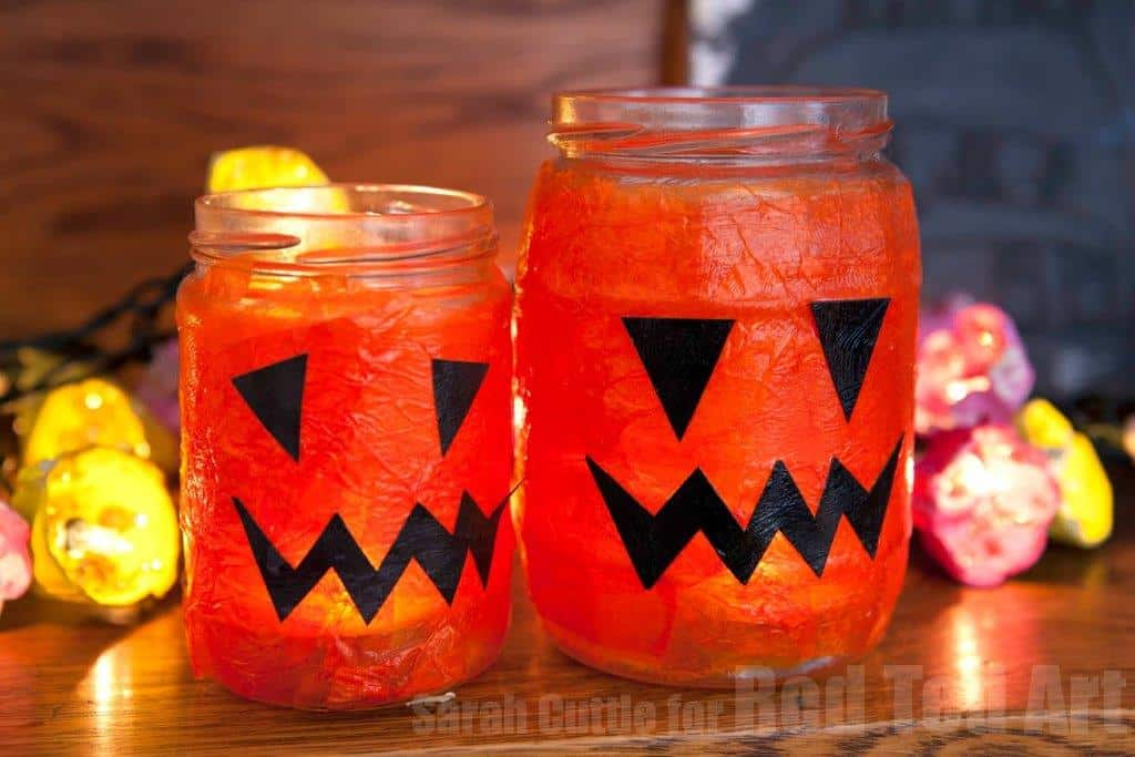 Easy Halloween Lanterns for Preschoolers - looking for cute Halloween Crafts for kids? These lanterns or luminaries are quick and easy to make and made from upcycled jars and tissue paper! They last really well too!