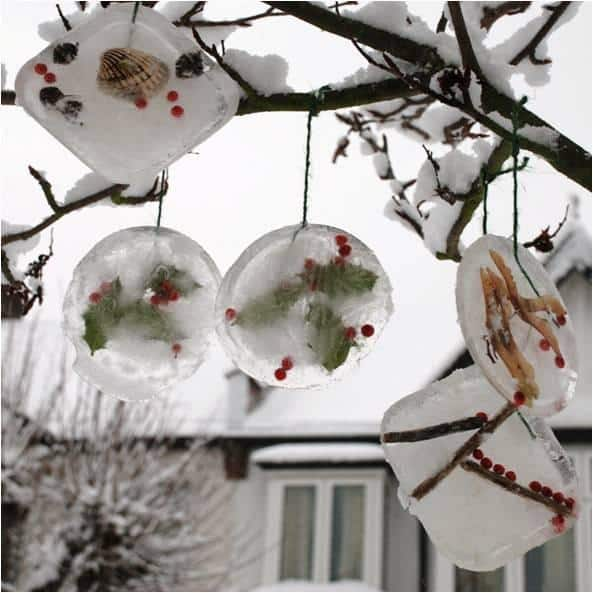 ICE ORNAMENTS - a super easy and simple STEAM experiment for kids. Exploring nature finds and science at the same time. Combine it with weather temperature charts, making this not only a super pretty Winter Craft for Kids, but also a great Homeschooling process and experiment!