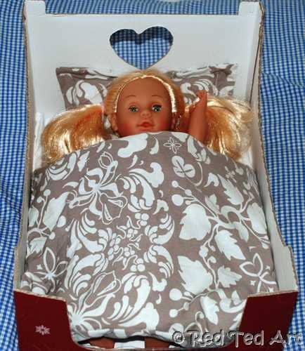 Doll's cardboard box bed