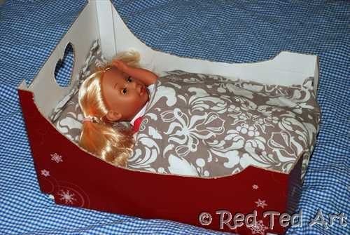 Doll's cardboard box bed