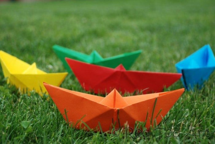 How to... make a Paper Boat! This is such an easy origami boat and it is so fun to play with, that it makes the perfect easy origami for kids to learn. We love making easy paper boats and you can decorate and play with them in so many ways. You can make tiny paper boats and GIANT origami boats. Pirate Boats or Rianbow Boats. Your choice. Check out how to make an origami boat today!! And see how easy paper boats are made.