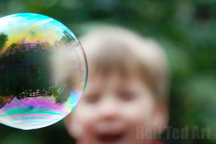 Giant Bubbles Recipe –  love these Homemade Bubbles. how to make your own bubble mixture tutorial, as well as how to make giant bubble wands. The kids always have such a blast with our DIY bubbles in the summer. #bubblerecipe #bubblemixture #diybubbles #giantbubbles