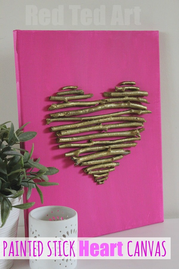 Painted stick heart canvas for Valentines. Super easy Valentine's Day Decoration or Valentine's Wall Hanging. Love the bold pink and contrast with the nature items. #Valentines #valentinesday #valentinesdaydecor #decor #nature #sticks #hearts