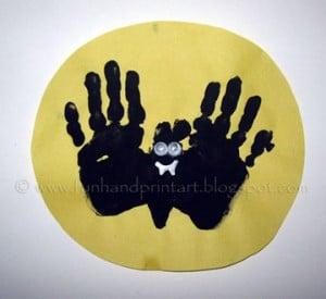 Handprint-bat-flying-over-moon-craft-300x275
