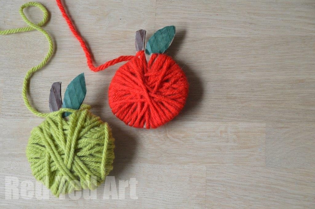 Yarn Wrapped Apple Crafts for Kids - 20 Apple Crafts for Fall - these apple DIY Ideas are just so cute. The kids will love having a go? Will it be apple print wreaths, yarn wrapped apple garlands or this adorable Paper Plate Apple and worm? Great Apple Crafts for Preschoolers to discover and have a go at!