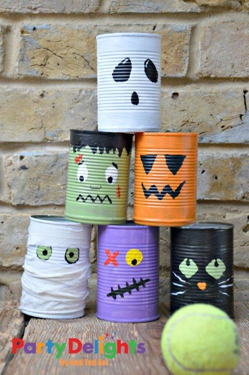 Super fun Halloween Party Activity - Halloween Tin Can Bowling! Make your own Halloween Characters from Frankenstein, to Zombies, Black Ctas and our favourite - the Mummy! #Halloween #Halloweenparty #halloweenpartygames #halloweenpartyactivities #tincan #recycling