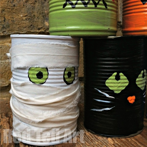 Halloween Tin Can Crafts - Mummy - Super fun Halloween Party Activity - Halloween Tin Can Bowling! Make your own Halloween Characters from Frankenstein, to Zombies, Black Ctas and our favourite - the Mummy! #Halloween #Halloweenparty #halloweenpartygames #halloweenpartyactivities #tincan #recycling