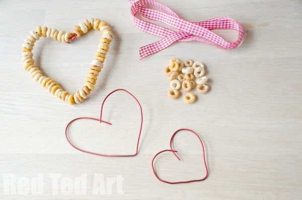 DIY Cheerios Bird Feeders - fine motor skill activity for kids