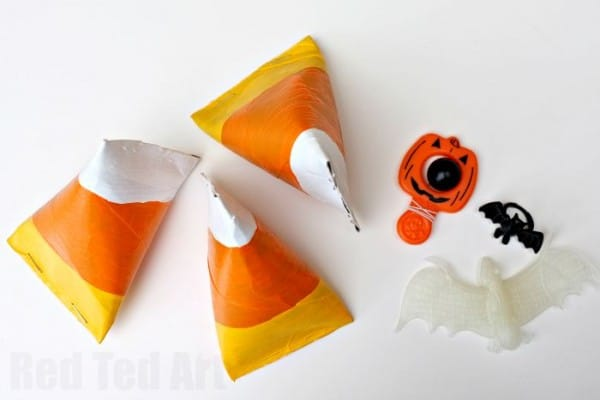 Easy Candy Corn Craft - turn TP Rolls into pyramid candy corn treat boxes perfect for Halloween and Thanks Giving
