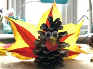 Easy Pine Cone Turkey. Make the most of those vibrant Fall Leaves for Thanksgiving