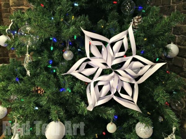 Easy 3D Paper Snowflake How To - these paper snowflakes or stars are beautiful and surpirsingly easy to make