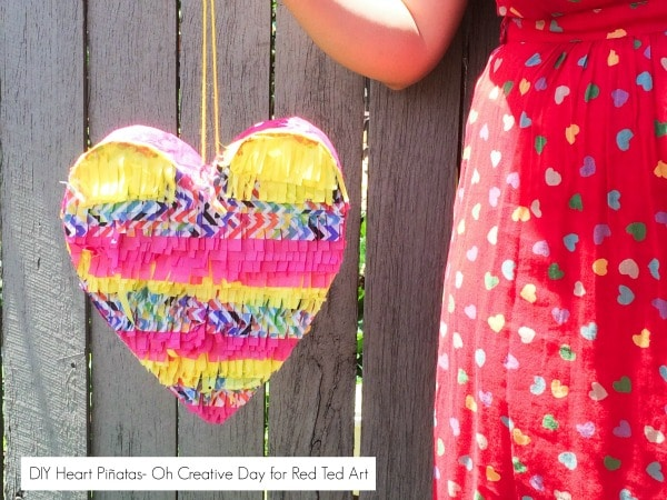 How to make a DIY Pinata Heart. Simply stunning! DIY Pinata Heart Craft - adorable Valentines Day Party Activity. Great Conversation Heart Craft too! #Party #Valentines #ConversationHeart #hearts