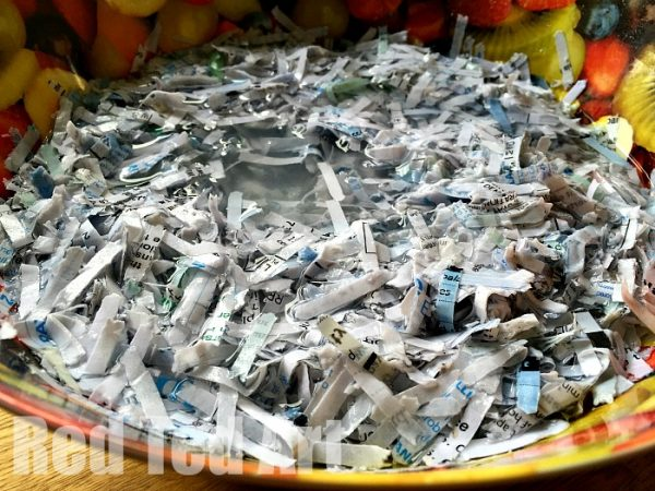 Soaking shredded paper to make paper clay