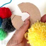 How to make a Yarn Pom Pom with Cardboard Discs