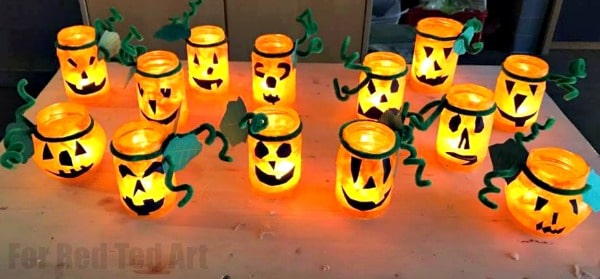 Halloween Luminaries - easy Jack O'Lantern Lights made from recycled mason jars #jackolantern #halloween #recycling #luminaries