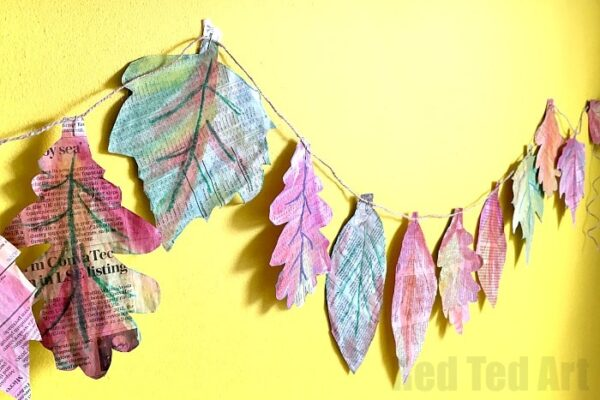 Wonderful Autumn Leaf Garland. This is a great Autumn Craft for Kids - combining nature, art and recycling! The kids will love it and the results are stunning! Explore, textures, shapes and colours and why not turn this into a collaborative project too?!