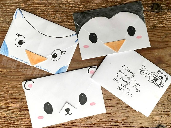 Cute Origami Envelopes - super cute and easy origami envelopes for Winter. These make great Christmas Letters, Thank You Letters, additions to Christmas gifts and tags or little notes to send just because. Love how easy these Animal Origami Envelopes are to make! Cutest Penguin, Polar Bear and Owl Designs!