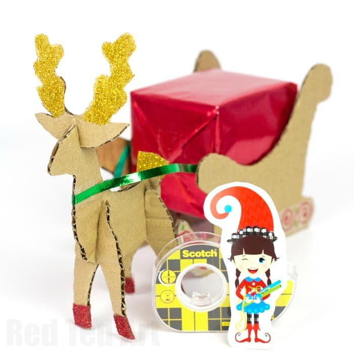 Reindeer Sleigh Gift Wrapping Idea - use these fab template to create your own Rudolph Sleigh! A great way to display gifts or even use it as a Christmas Centre piece. TOO cute!
