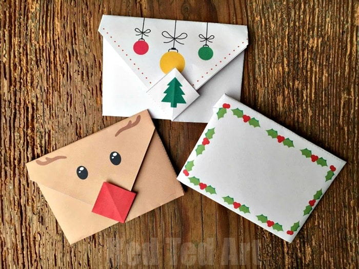 Cute Origami Envelopes - super cute and easy origami envelopes for Winter. These make great Christmas Letters, Thank You Letters, additions to Christmas gifts and tags or little notes to send just because. Love how easy these Animal Origami Envelopes are to make! Cutest Penguin, Polar Bear and Owl Designs! Includes free Christmas Printable Envelopes!