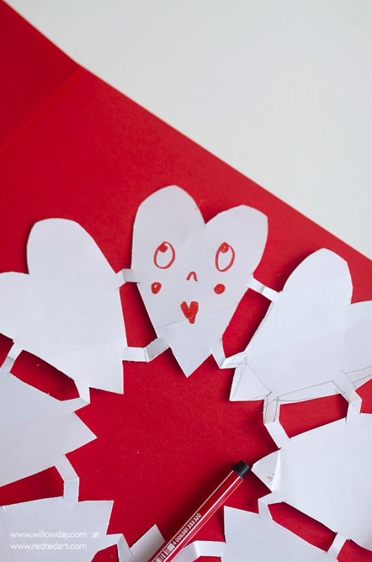 Valentines Paper Heart Snowflakes - a gorgeous Valentines Day decoration or quirky Valentines Day Card for kids to make. So lovely!