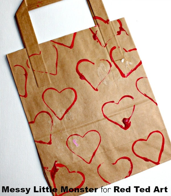 Cookie Cutter Heart Art - a wonderful Valentine Project for Preschoolers and Toddlers. Love how cheerful and fun these Heart Print Canvases are. A great process for DIY gift wrap and valentine gift bags too!
