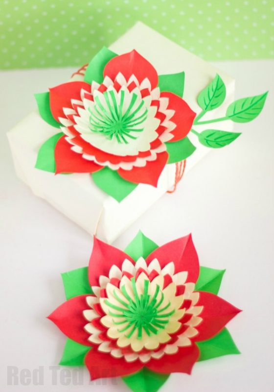 Pretty Paper Flowers DIY including Template - These paper flowers look stunning as paper decorations at a wedding, as part of a Gift Wrap decoration or even as a delicate diy flower hair piece. Beautiful Paper Flower DIY!!