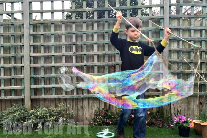Giant Bubbles Recipe – how to make your own bubble mixture tutorial, as well as how to make giant bubble wands. The kids always have such a blast with our DIY bubbles in the summer.