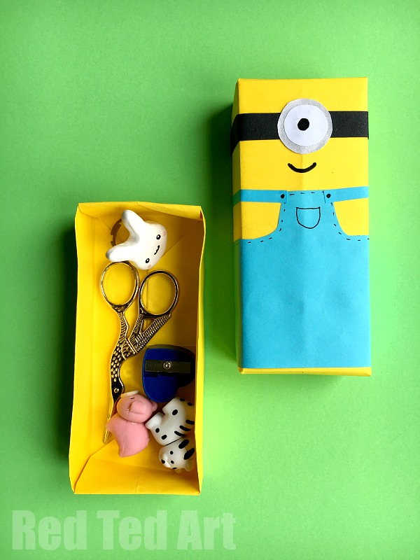 Minion Paper Box Craft - we love a good Minion DIY. Despicable Me characters are just so cute and fun. Today we have a Minion Paper Craft for you - easy DIY Minion Paper Boxes. Great for trinkets and small desk tidies!