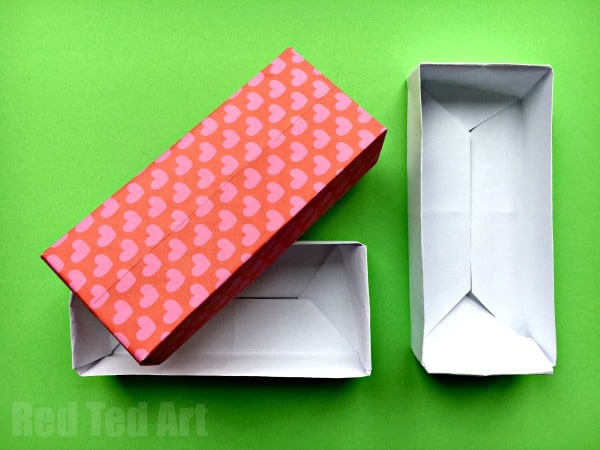 Easy Rectangular Origami Box. We love simple paper crafts. This Origami box is great for beginners to learn. It is the perfect little Origami Gift Box but also great for text organisation and trinkets. Store your paper clips and erasers or use it for sorting jewelry. Easy Rectangular Origami Box. Great Paper Box DIY