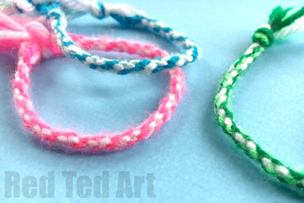 Cardboard Circle Bracelet DIY. How to make Friendship Bracelets with a Cardboard Loom - easy yarn bracelets for kids. Great for road trips and summer camps!