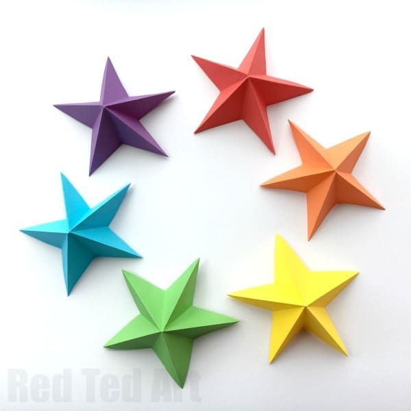 3D Paper Star Kirigami - pretty and super easy paper stars. Learn how to make these paper stars quickly and easily. They are perfect as Christmas Decorations (yellow), Fourth of July Decorations (white), New Year's Eve (Gold and Silver) or for a special party (rainbow!!). One 3D Paper Star How To.  #3dPaperStar #paperstar #paperstars #howtomakeastar #papercrafts