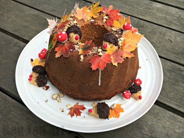 Thanksgiving Cake Decorating Ideas - How cute is this Fall Cake? Completely edible and oh so cute! We made this as my Mother in Law's Birthday Cake. The kids helped make the cake, hedgehogs and mushrooms.. the assembly of this Birthday/ Thanksgiving cake is super easy too!