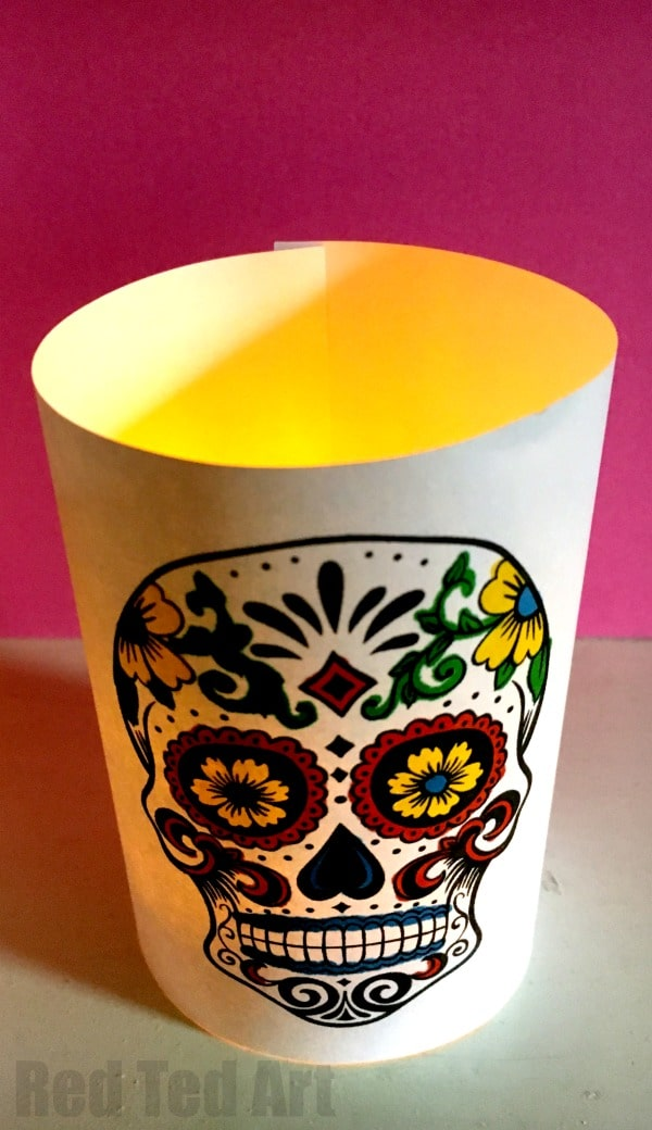 Day of the Dead Crafts and Activities for Kids featured by top Seattle lifestyle blogger, Marcie in Mommyland: Paper Day of the Dead Luminaries - a great 5 minute craft. Have these Day of the Dead Sugar Skull Luminaries made in minutes. Either colour yourself, or use the coloured versions, for a super quick and easy Halloween decoration. LOVE THESE.