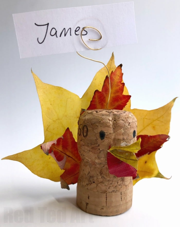 Leaf Turkey Craft - Thanksgiving Place Cards - A quick 5 minute craft for Thanksgiving. These little leaf turkey corks are quick and easy to make. They are a great little decoration or place card for thanksgiving. Either use fresh leaves (for temporary look) or preserve your leaves (info linked in article) first.. but aren't they adorable?
