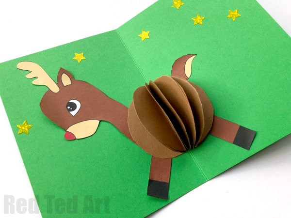 3D Reindeer Card DIY - oh we do love a homemade card. Here is a super cute Pop Up Reindeer Card. Make your own Rudolph or use the handy free printable. Love 3D DIY Christmas cards. #Christmas #Christmascards #popup #templates