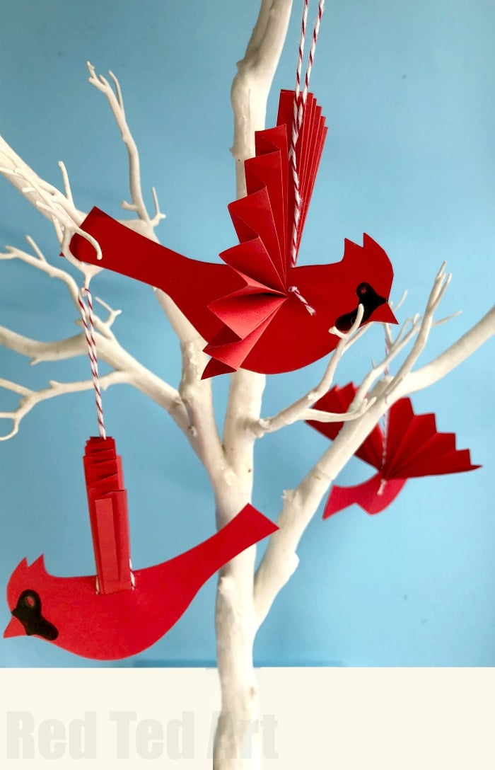 Easy Paper Fan Cardinal Ornament for Christmas. How to make a paper fan bird. This stunning red bird ornament is a beautiful Christmas Ornament. Make it from scratch or make use of the handy Cardinal Template. Aren't they simply vibrant? Love paper crafts for Christmas! #papercrafts #paperbird #papercraftsforkids #paperornaments #ornament #cardinal #papercardinal