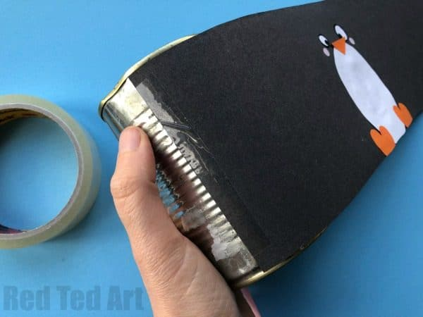 DIY Penguin Pencil Holder - teehee, how cute are these little Penguin Desk Tidies? A great 5 minute craft to decorate for Winter!! Love upcycling in this way. #pencilholder #penpots #desktidies #penguin #penguindiy #winter #winterdecor #wintercrafts #5minutecrafts