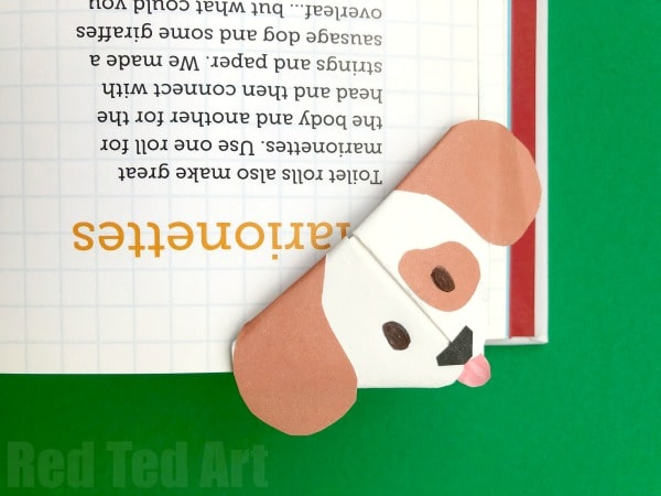 Chinese New Year Dog Crafts: Emoji Dog Corner Bookmark - Cute little Dog Bookmark craft based on the Emoji Dog design Pops over the edges of your book. Oh so cute! Love Paper Dog Crafts for Kids. #Dogs #dogdiys #dogcrafts #dogcraftsforkids #chinesenewyear #yearofthedog