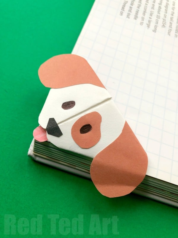 Emoji Dog Corner Bookmark - Cute little Dog Bookmark craft based on the Emoji Dog design Pops over the edges of your book. Oh so cute! Love Paper Dog Crafts for Kids. #Dogs #dogdiys #dogcrafts #dogcraftsforkids #chinesenewyear #yearofthedog