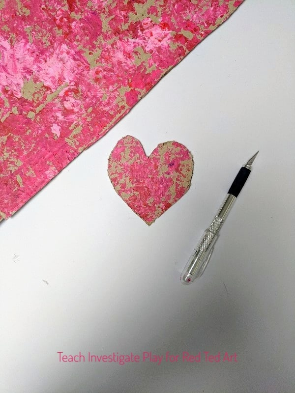 Process Art Valentine's Wall Hanging. Process Art Valentine's Wall Hanging - a wonderful process art project for Valentine's. Let the kids go wil dwith their creativity, explore print making and colour mixing and make these gorgeous heart wall hangings for Valentines! #valentines #valentinesday #processart #artforkids #kidscraft