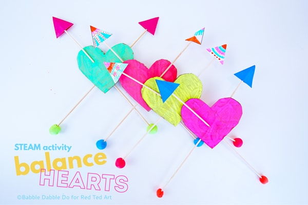 Balancing Hearts Valentine's Kids Activity. Make these super fun STEAM Heart Toys for Valentines. #valentines #steam #valentinesscience #science #kidsvalentines