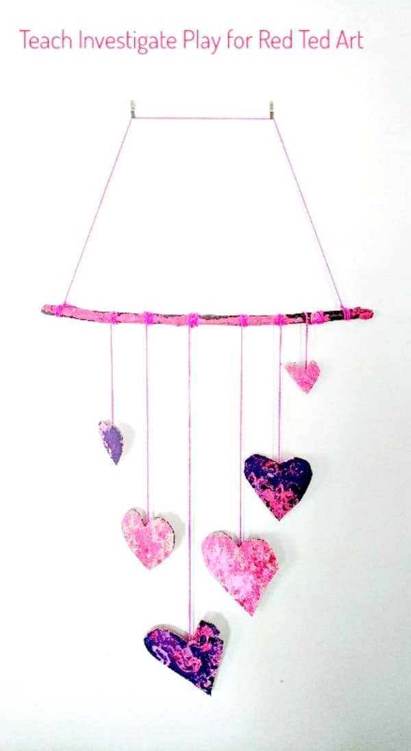 Process Art Valentine's Wall Hanging - a wonderful process art project for Valentine's. Let the kids go wil dwith their creativity, explore print making and colour mixing and make these gorgeous heart wall hangings for Valentines! #valentines #valentinesday #processart #artforkids #kidscraft