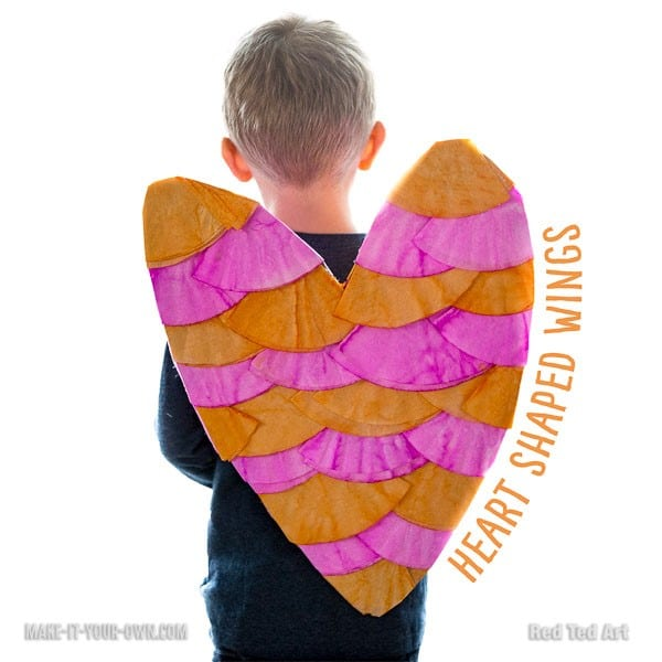 Kids' Valentine's Day Crafts - love these oh so CUTE Heart Shaped Wings for Valentine's. A different kind of love project to do with the kids this year! #valentinesday #valentines #hearts #heartcraft #cardboard #kidsvalentines