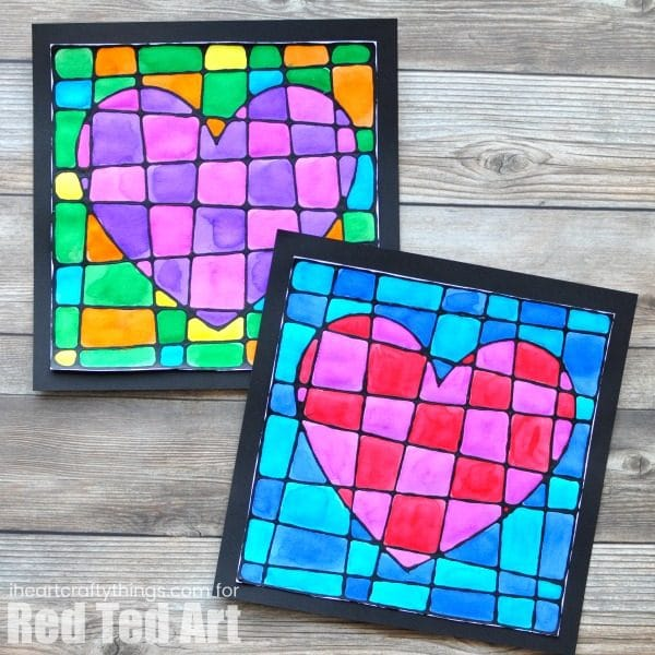 Black Glue Heart Art Project - Stained Glassed Heart Art. How beautiful is this art projects for kids this Valentine's Day? Would make a gorgeous gift too! #blackglue #heartart #valentinesday #artprojects #kidscrafts #art