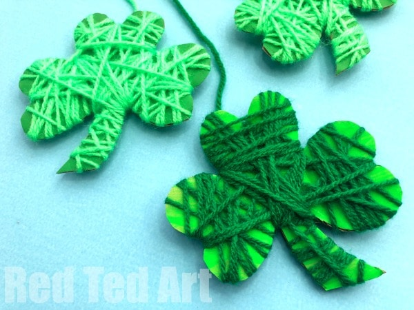 Yarn Wrapped Shamrock Craft for Preschoolers. Easy Shamrock Decoration for St Patrick's Day. Love this Shamrock Template and great toddler St Patrick's Day Craft. They would make great Shamrock Garlands or simple decorations. Add googly eyes to make Shamrock Critters for Preschool #shamrocks #stpatricksday #preschool #critters #toddler