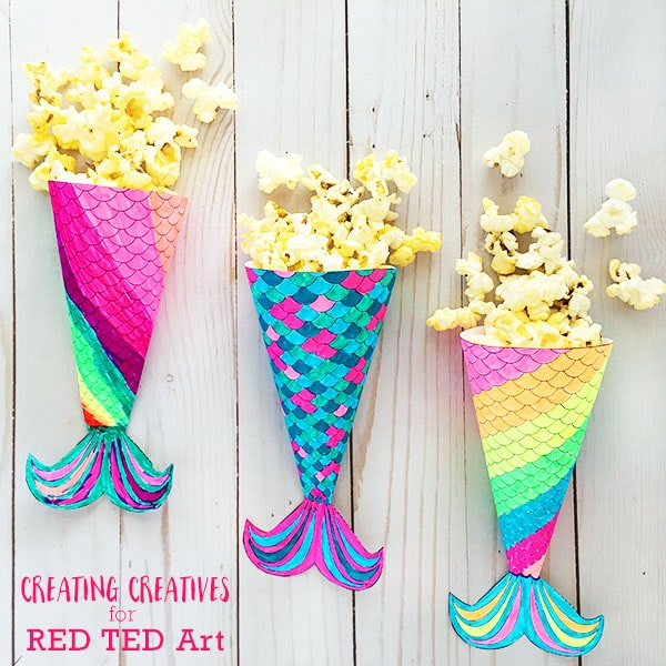 Mermaid Movie Night Printable. Make your own Mermaid Popcorn Holders. Perfect for a Mermaid Party or Mermaid Movie Night! Enjoy this adorable and free Mermaid Tail Printable! #mermaids #party #movienight #printables